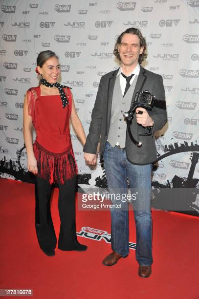 Singer Jesse Cook and Nancy Cardwell pose on the red carpet at the 2011 Juno Awards at the Air Canada Centre on March 27 2011 in Toronto Canada