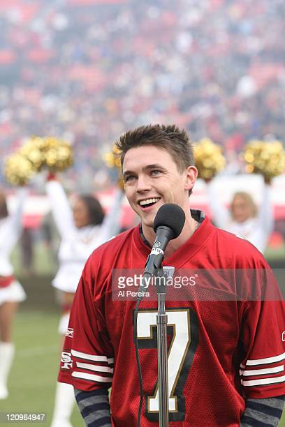 Singer Jesse McCartney sings the National Anthem when the New York Jets visit the San Francisco 49ers on December 7 2008 at Candlestick Park San...
