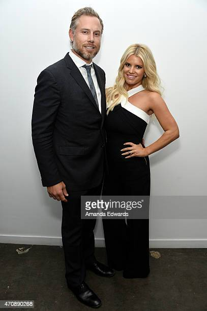 Singer Jessica Simpson and her husband Eric Johnson attend a special preview of The Gleason Project at ZEFR Warehouse on April 23 2015 in Venice...