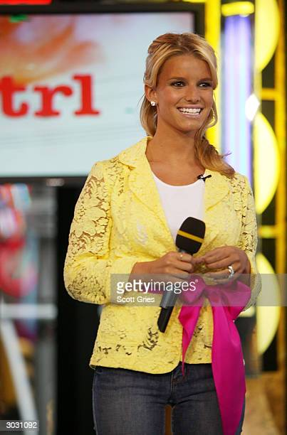 Singer Jessica Simpson appears on stage during MTV's Total Request Live at the MTV Times Square Studios March 1, 2004 in New York City.