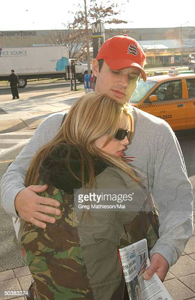 Singer Jessica Simpson hugging boyfriend, singer for 98 Degrees, Nick Lachey before leaving on USO tour to entertatin US troops overseas during the...