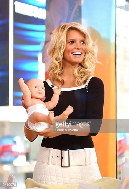 Singer Jessica Simpson takes part in a baby changing contest against her husband Nick Lachey on MTV TRL at the MTV Times Square Studios August 19...
