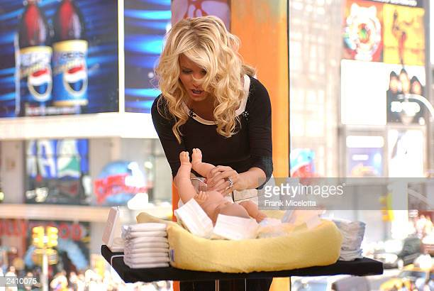 Singer Jessica Simpson takes part in a babychanging contest against her husband Nick Lachey on MTV TRL at the MTV Times Square Studios August 19 2003...