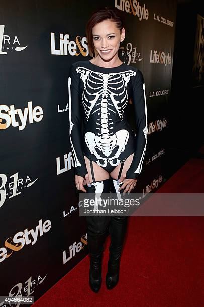 Singer Jessica Sutta attends Life Style Weekly's Eye Candy Halloween Bash hosted by LeAnn Rimes at Riviera 31 at Sofitel on October 29 2015 in Los...