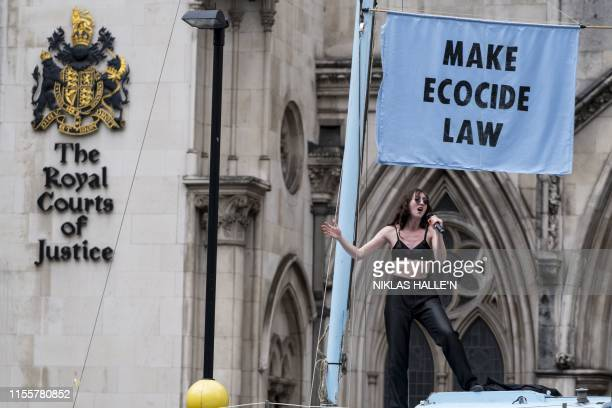 Singer Jessica Winter entertains demonstrators from the Extinction Rebellion climate environmental activist group protesting outside of The Royal...