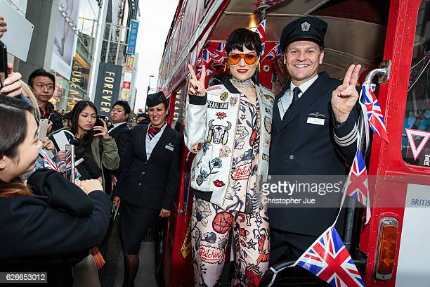 Singer Jessie J poses on a red London Bus during a media event to mark the British Airways London for Less campaign on November 30 2016 in Tokyo...
