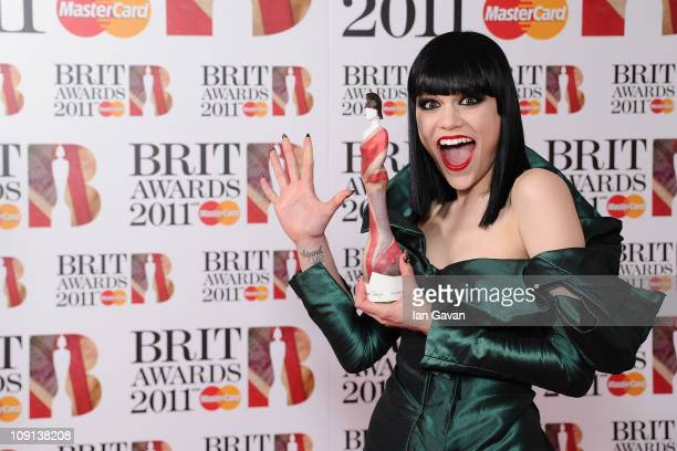 Singer Jessie J poses with her Critic's Choice Award in the winners area at the BRIT Awards 2011 at the O2 Arena on February 15 2011 in London England