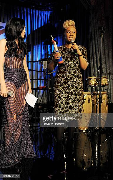 Singer Jessie J presents the 2012 BRITS Critics Choice award to Emeli Sande at the nominations announcement for the BRIT Awards 2012 at The Savoy...