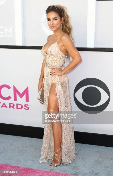 Singer Jessie James Decker arrives for the 52nd Academy of Country Music Awards on April 2 at the TMobile Arena in Las Vegas Nevada / AFP PHOTO /...