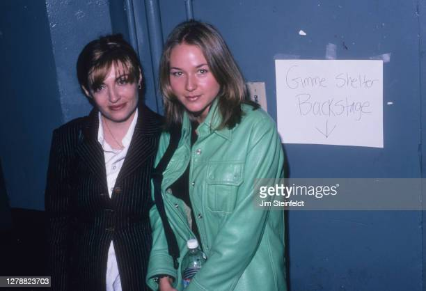 Singer Jewel on right poses for a portrait at the Gimme Shelter benefit concert at the Palace Theatre in Los Angeles, California on November 20, 1995.