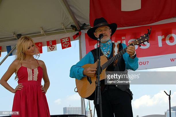 Singer Jewel performs with her Father Atz Kilcher at Swiss National Day on Ellis Island in New York City