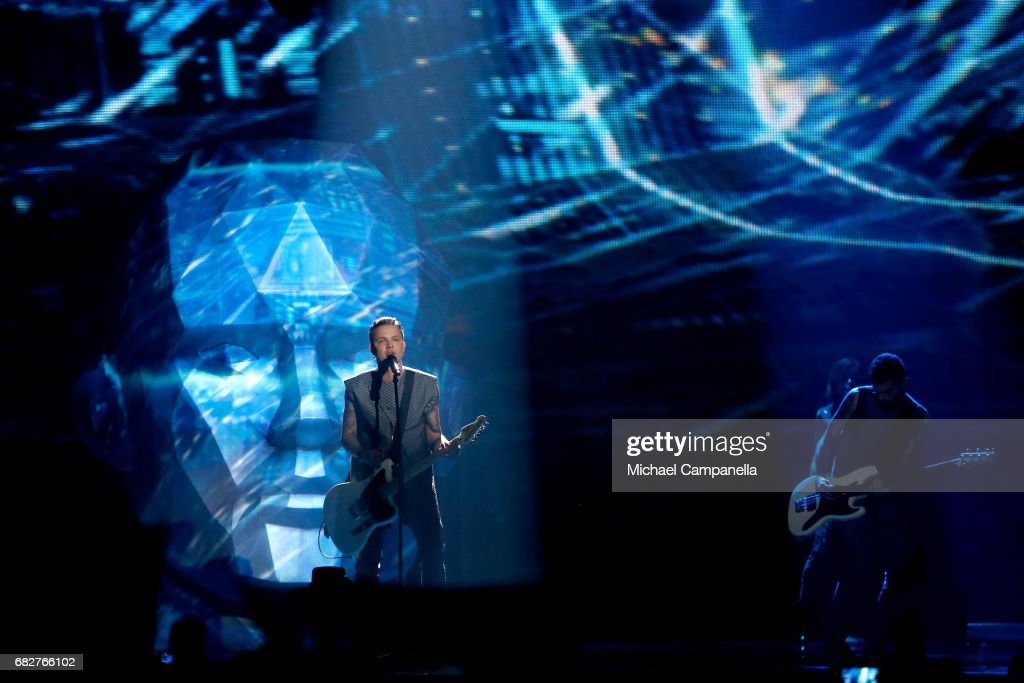 Singer Jewhen Halytsch of the band O.Torvald, representing Ukraine, performs the song 'Time' during the final of the 62nd Eurovision Song Contest at International Exhibition Centre (IEC) on May 13, 2017 in Kiev, Ukraine.