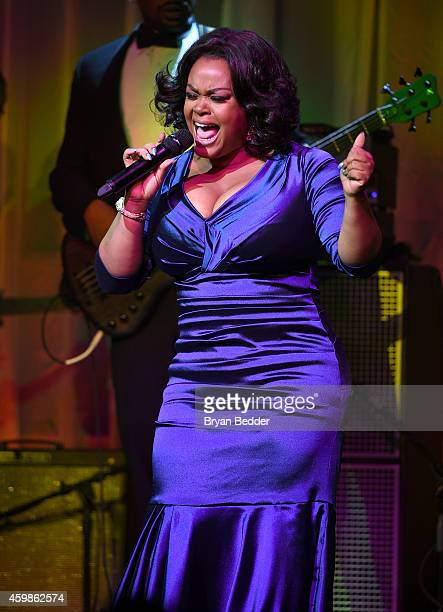 Singer Jill Scott performs onstage at the Tenth Annual UNICEF Snowflake Ball at Cipriani Wall Stree on December 2 2014 in New York City