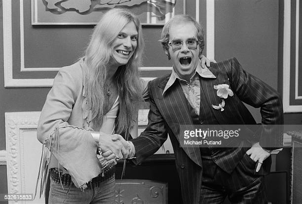 Singer Jim 'Dandy' Mangrum of American Southern rock group Black Oak Arkansas with English singersongwriter and pianist Elton John February 1975