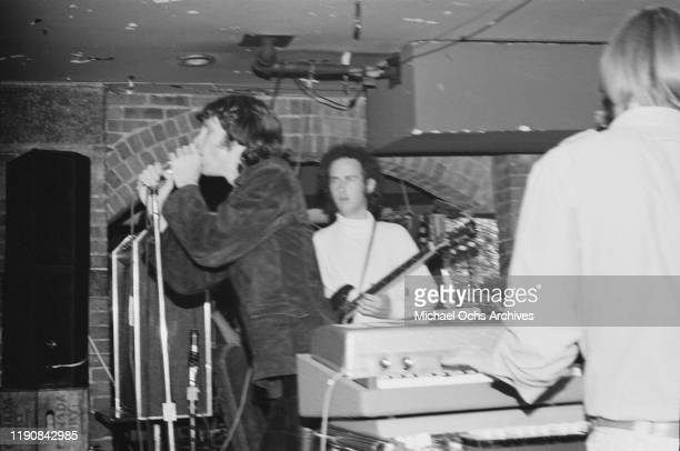 Singer Jim Morrison and guitarist Robby Krieger of American rock band the Doors performing at Steve Paul's The Scene in New York City, circa 1967.