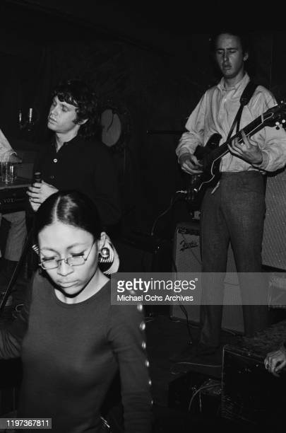 Singer Jim Morrison and guitarist Robby Krieger of American rock band The Doors perform at the Ondine Club in New York City November 1966