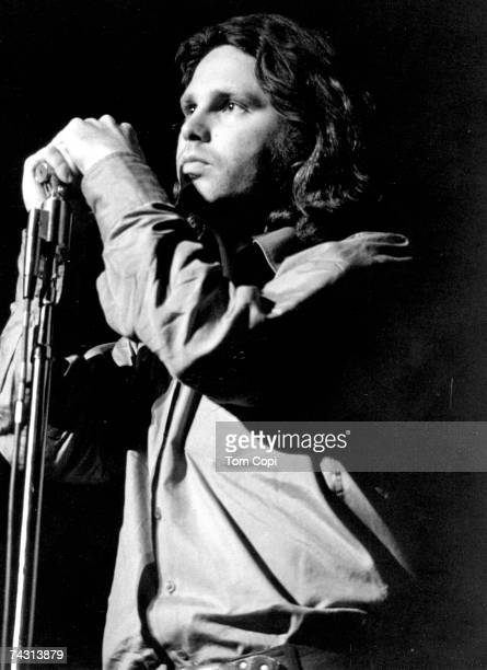 Singer Jim Morrison of The Doors performs at the Cobo Arena on May 8 1970 in Detroit Michigan