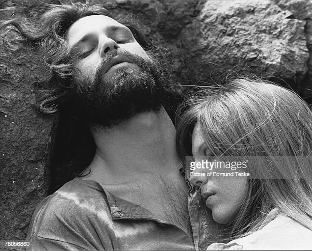 Singer Jim Morrison of The Doors with girlfriend Pamela Courson during a 1969 photo shoot at Bronson Caves in the Hollywood Hills California