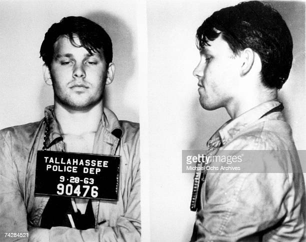 Singer Jim Morrison of the rock and roll band The Doors mugshot on September 28 1963 on charges of petty larceny disturbing the peace resisting...