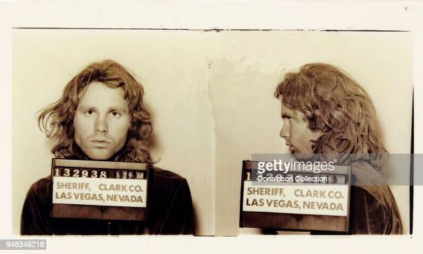 Singer Jim Morrison of the rock and roll band The Doors' mugshot on January 29 1968 in Las Vegas Nevada