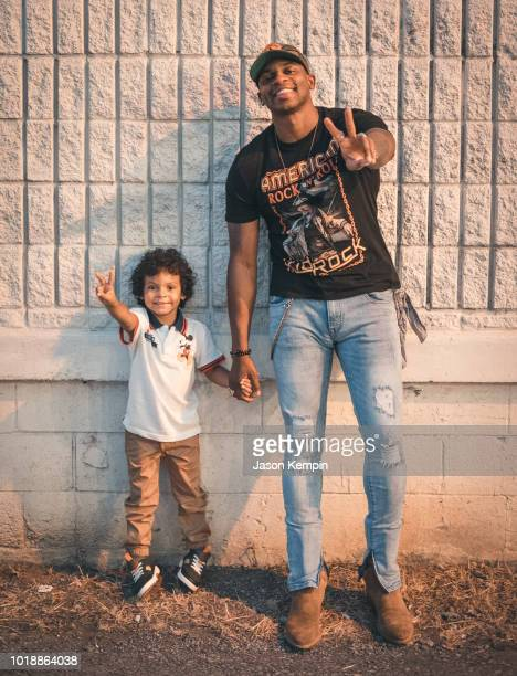 Singer Jimmie Allen poses with son Aiden for a portrait at The Listening Room on August 13 2018 in Nashville Tennessee