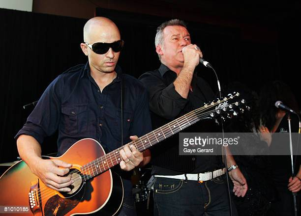 Singer Jimmy Barnes performs with brotherinlaw and good friend Mark Lizotte during the launch of his biography at the Hilton Hotel on May 7 2008 in...