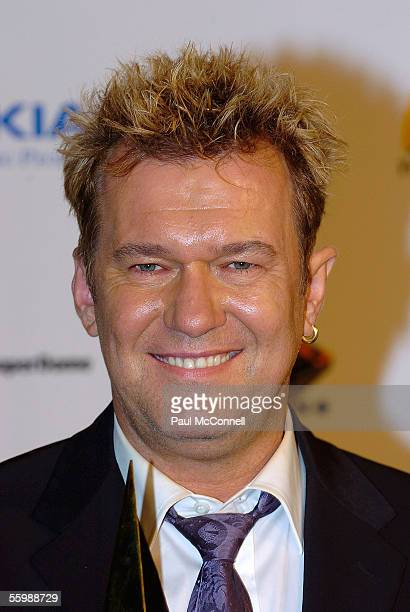 Singer Jimmy Barnes with Hall Of Fame award poses in the media room at the 19th Annual ARIA Awards at the Sydney SuperDome on October 23, 2005 in...