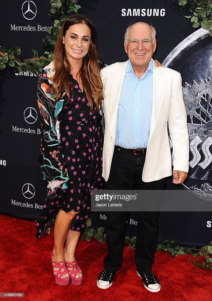 Singer Jimmy Buffett (R) and guest attend the premiere of 'Jurassic World' at Dolby Theatre on June 9, 2015 in Hollywood, California.