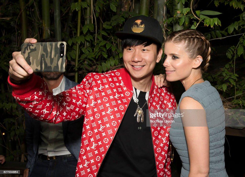 Singer JJ Lin and actress Kate Mara take an iphone selfie at