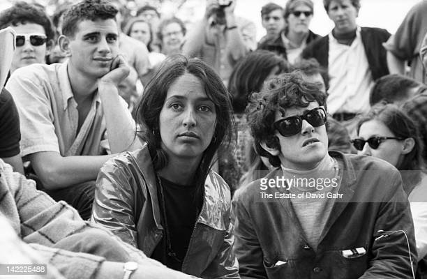 Singer Joan Baez and singer/songwriter Donovan backstage at the Newport Folk Festival in July 1965 in Newport Rhode Island