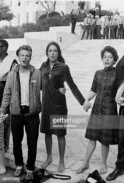 Singer Joan Baez on the steps of the Alabama State Capitol Montgomery Alabama at the culmination of the Selma to Montgomery March March 1965