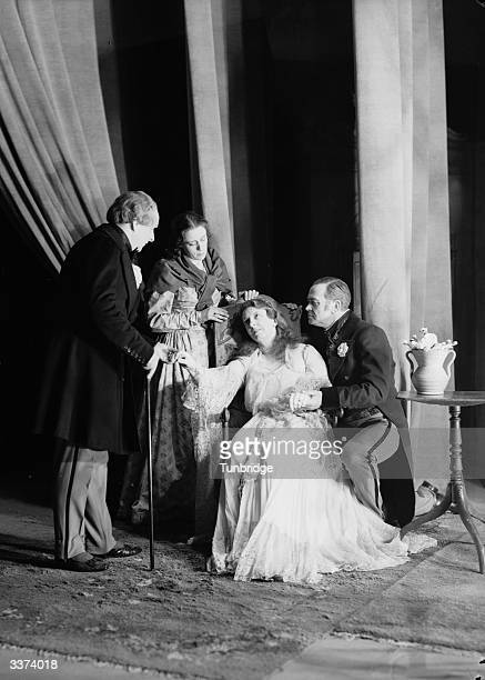 Singer Joan Cross plays the dying Violetta in a production of Verdi's opera 'La Traviata' at the Sadler's Wells Theatre London