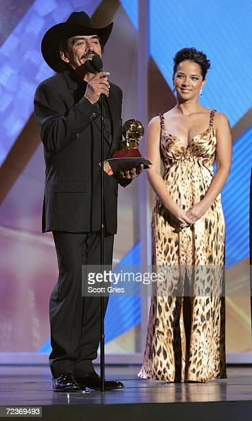 Singer Joan Sebastian accepts the award for Best Banda Album from actress Adamari Lopez presents an award onstage at the 7th Annual Latin Grammy...