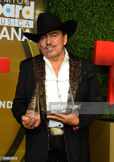 Singer Joan Sebastian poses in the pressroom with the awards for 'Ranchero/Mariachi Album 13 Celebrando El 13' and Ranchero/Mariachi Artist of the...