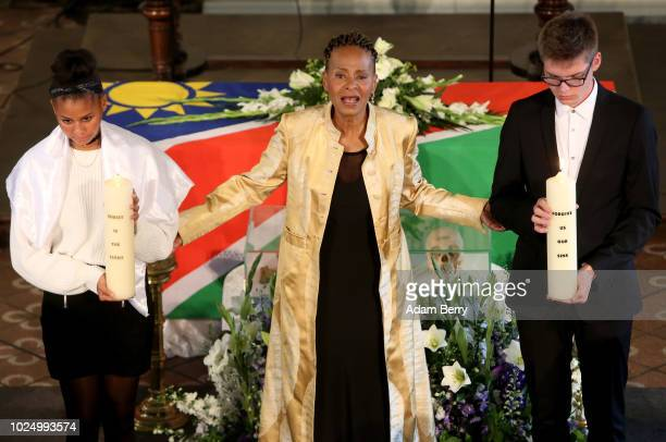 Singer Jocelyn Bernadette Smith performs during a ceremony for the repatriation of Namibian skulls from the German Empire's murderous campaign in...