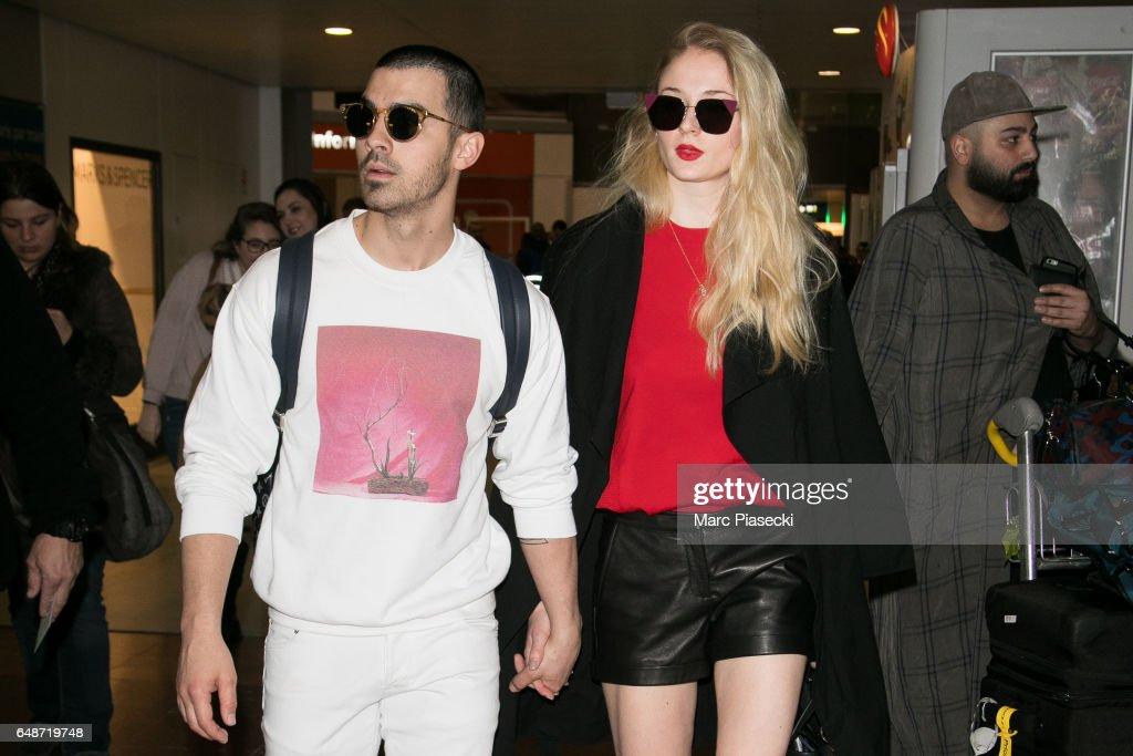 Celebrity Sighting At Paris Airport  - Paris Fashion Week Womenswear Fall/Winter 2017/2018 : News Photo