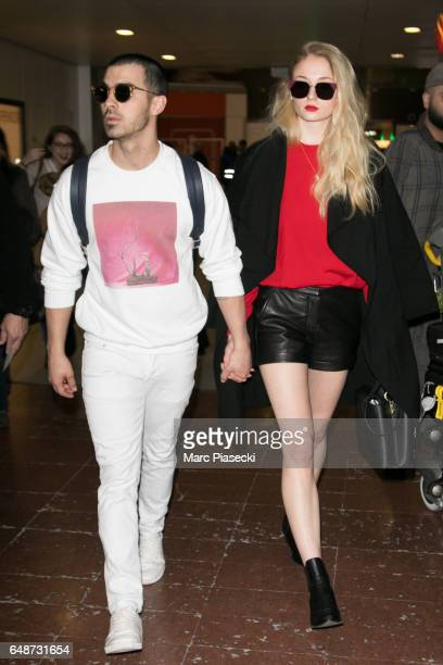 Singer Joe Jonas and actress Sophie Turner arrive at Aeroport Roissy Charles de Gaulle on March 6 2017 in Paris France