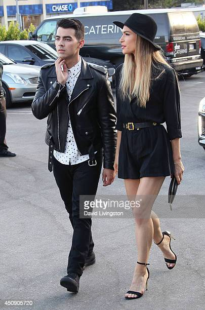 Singer Joe Jonas and artist Blanda Eggenschwiler attend the Cadillac and Refinery29 launch party hosted by Kelly Osbourne at Hyde on Sunset on June...