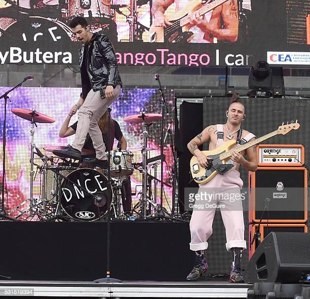 Singer Joe Jonas and bass player Cole Whittle of DNCE perform at 1027 KIIS FM's Wango Tango 2016 at StubHub Center on May 14 2016 in Carson California