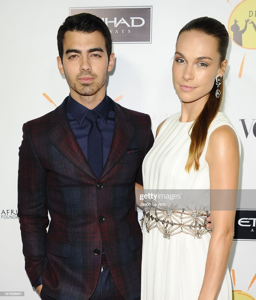 Singer Joe Jonas and Blanda Eggenschwiler attend the Dream For Future Africa Foundation gala at Spago on October 24, 2013 in Beverly Hills, California.