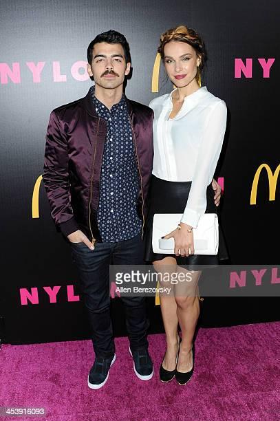 Singer Joe Jonas and girlfriend Blanda Eggenschwiler attend NYLON Magazine's December Issue Celebration featuring cover star Demi Lovato at Smashbox...