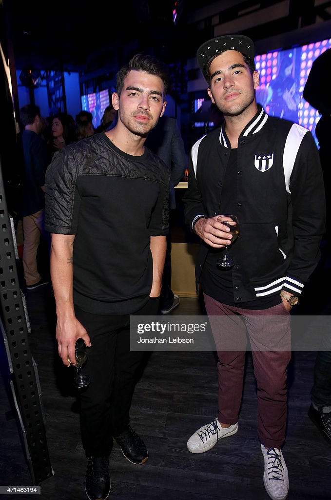 Singer Joe Jonas (L) and guest attend the Samsung Studio LA Launch Event across from the Grove on April 28, 2015 in Los Angeles, California.