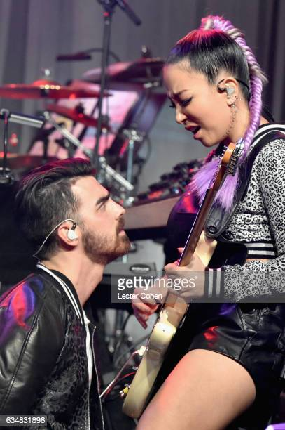 Singer Joe Jonas and musician JinJoo Lee of DNCE perform onstage at PreGRAMMY Gala and Salute to Industry Icons Honoring Debra Lee at The Beverly...