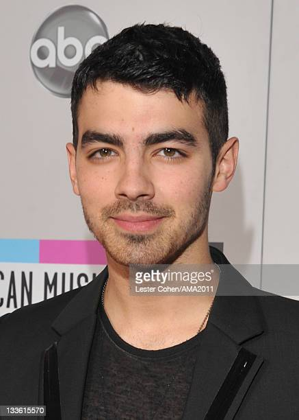 Singer Joe Jonas arrives at the 2011 American Music Awards held at Nokia Theatre LA LIVE on November 20 2011 in Los Angeles California
