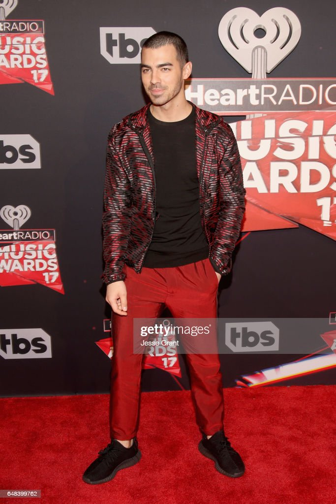 Singer Joe Jonas attends the 2017 iHeartRadio Music Awards which broadcast live on Turner's TBS, TNT, and truTV at The Forum on March 5, 2017 in Inglewood, California.