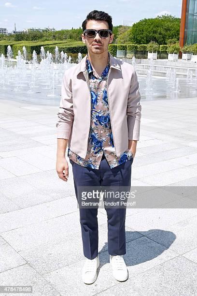 Singer Joe Jonas attends the Louis Vuitton Menswear Spring/Summer 2016 show as part of Paris Fashion Week on June 25 2015 in Paris France