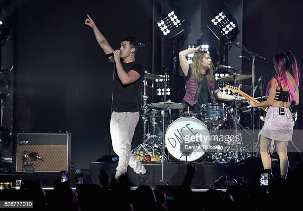 Singer Joe Jonas Jack Lawless and JinJoo Lee of DNCE perform during opening night of the Selena Gomez 'Revival World Tour' at the Mandalay Bay Events...