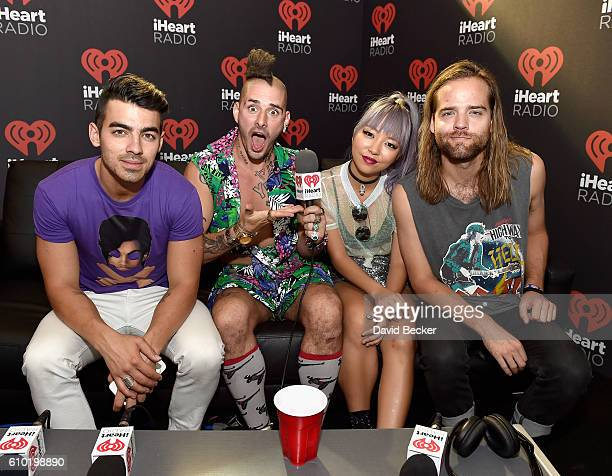 Singer Joe Jonas musicians Cole Whittle JinJoo Lee and Jack Lawless of DNCE attend the 2016 Daytime Village at the iHeartRadio Music Festival at the...