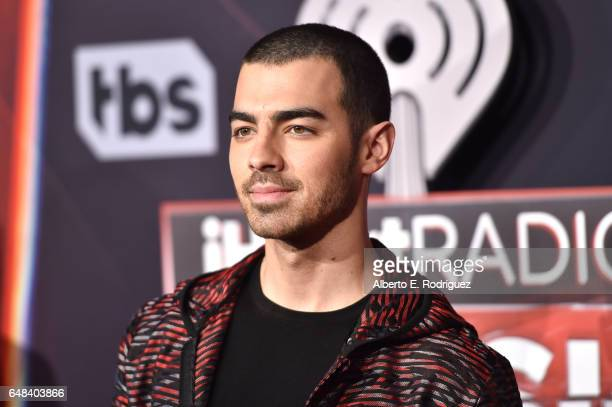 Singer Joe Jonas of music group DNCE attends the 2017 iHeartRadio Music Awards which broadcast live on Turner's TBS TNT and truTV at The Forum on...