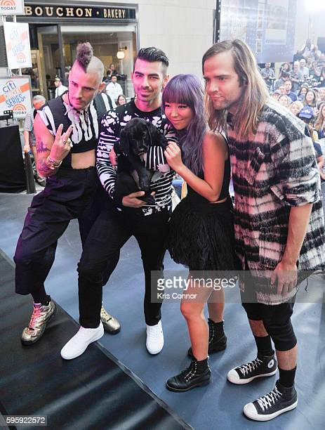 Singer Joe Jonas while wearing a pair of Lacoste Explorateur shoes performs with DNCE bandmates JinJoo Lee Cole Whittle and Jack Lawless on NBC's The...